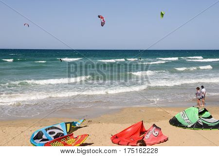 People Practicing Kitesurf On The Beach Of Torre Canne