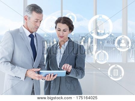 Digital composite of businesspeople using digital tablet with multiple models interface against cityscape background