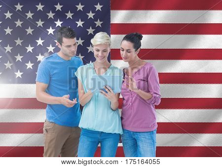 Digital composite image of executives using digital tablet against american flag