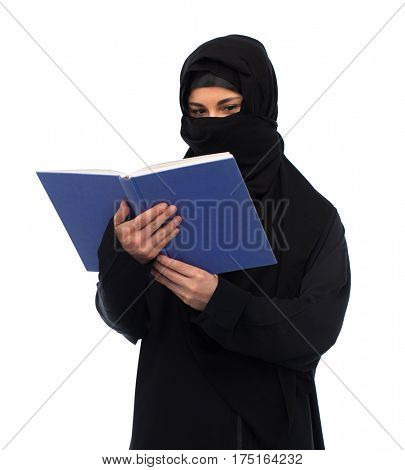 religion, education and people concept - muslim woman in hijab reading book over white background