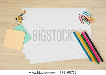 Still life from stationery on a wooden table