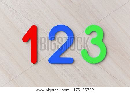 Multi-colored number one two and three on a wooden table horizontally