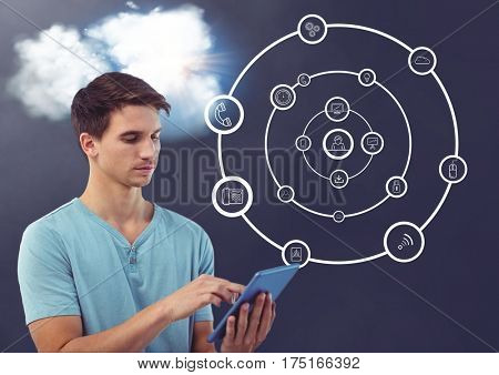 Digital composition of man using digital tablet with cloud and connecting icons in background