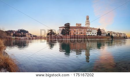historical quarter of Verona, panorama from river on ponte Pietra bridge and Duomo Cathedral at sunrise