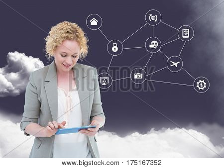 Digital composition of businesswoman using digital tablet with networking icons and cloud in background