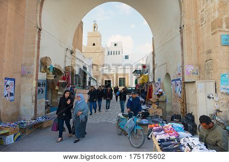 SFAX, TUNISIA - NOVEMBER 30, 2011: Unidentified people pass through the medina in Sfax, Tunisia.