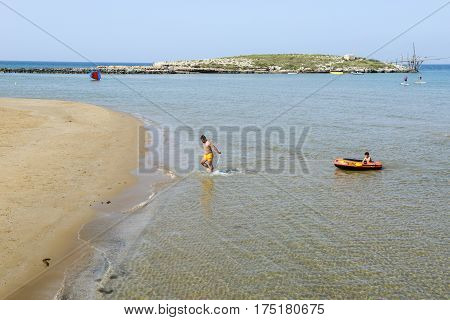 Torre Canne Italy - 28 June 2016: beach and island on the coast of Torre Canne on Puglia Italy