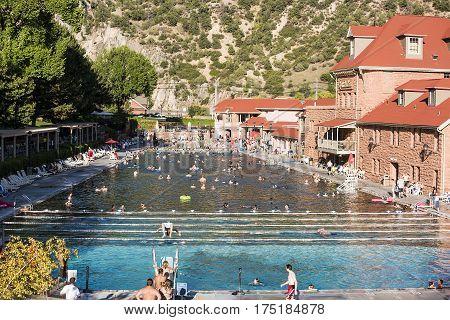 Glenwood Springs, Colorado - September 7, 2015: People bath at public hot springs pool in Glenwood Springs, Colorado, USA.