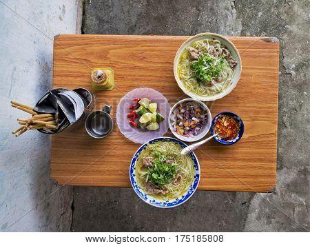 close up of vietnamese street food beef noodles bun bo