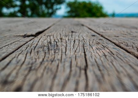 Wooden floor over a beautiful blurred nature
