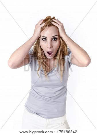 portrait of attractive woman surprised and excited in shock and disbelief isolated on white background in surprise emotion and opened mouth surprise face expression