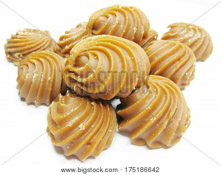 dairy brown sweetmeats in heap isolated on white background