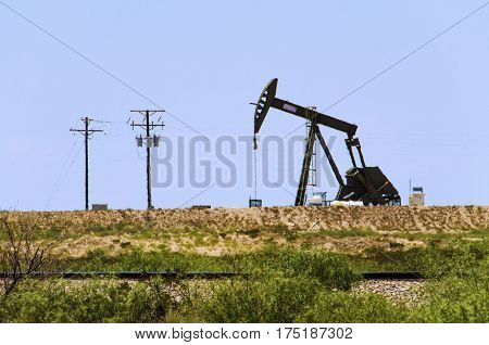 Pumpjack on Oilfields in prairies of Texas.