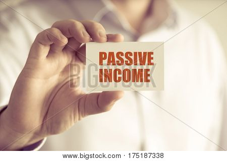 Businessman Holding Passive Income Message Card