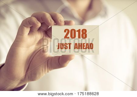Businessman Holding 2018 Just Ahead Message Card