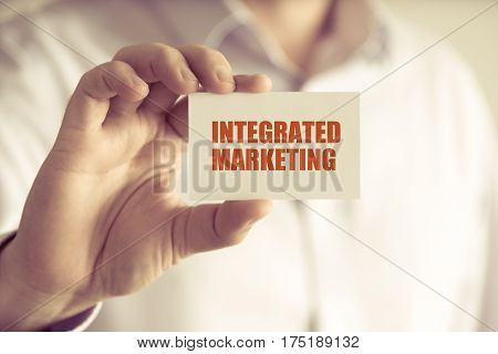 Businessman Holding Integrated Marketing Message Card