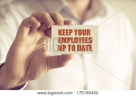 Businessman Holding Keep Your Employees Up To Date Message Card