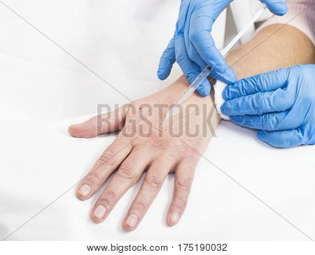 Mesotherapy process on a female hand in clinic