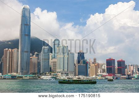 HONG KONG - May 28 2015: Hong Kong Skyline, blue sky, clouds and Star Ferries, May 28, 2015 in Hong Kong.