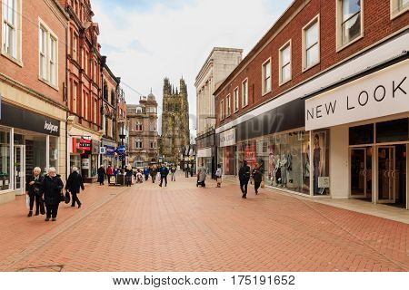 Wrexham Wales Uk - May 3 2016: The Welsh border market town of Wrexham one of the largest towns in North East Wales showing the central shopping district on Hope Street leading to the High Street and Saint Giles parish church