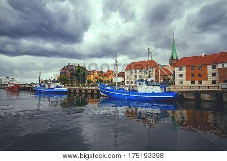 ELSINORE DENMARK 14 JUNE: fishing boats moored to the quay at Elsinore harbor near the city Helsingor Denmark in 2012