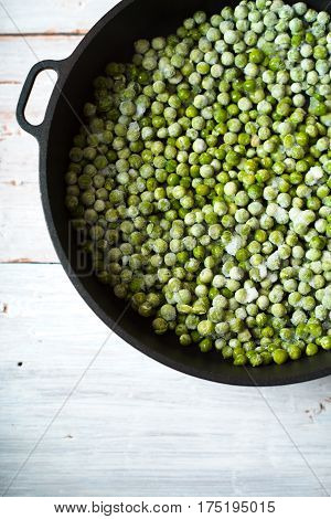 Green beans mung beans in a saucepan on white boards vertical