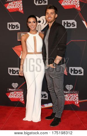 LOS ANGELES - MAR 5:  Ashley Iaconetti, Luke Pell at the 2017 iHeart Music Awards at Forum on March 5, 2017 in Los Angeles, CA