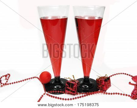 two goblets of red wine with present boxes
