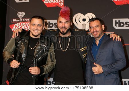LOS ANGELES - MAR 5:  IAmChino, Chacal, Jorge Gomez at the 2017 iHeart Music Awards at Forum on March 5, 2017 in Los Angeles, CA