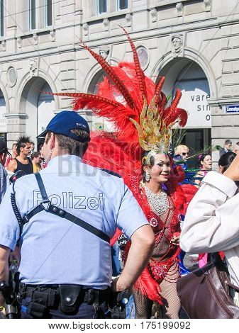 Zurich Switzerland - August 11 2008: Techno parade with transgender drag queen woman in costume and policeman