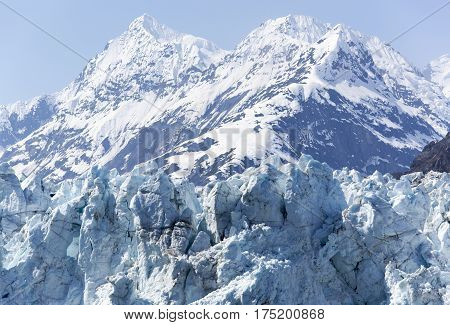 The top of a glacier and the peak of a mountain in Glacier Bay national park (Alaska).
