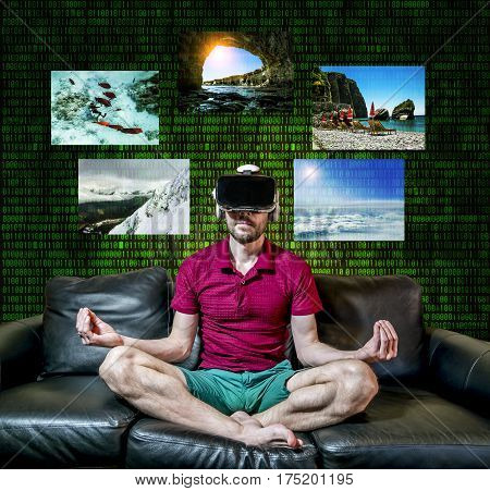 The man in glasses virtual reality sitting in the Lotus position on a black sofa at home on digital background matrix