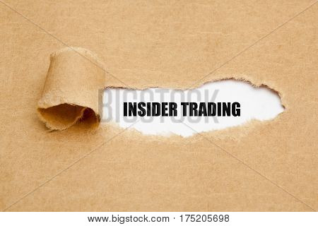 Text Insider Trading appearing behind ripped brown paper.