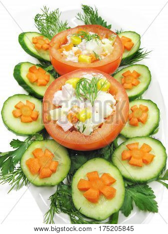 stuffed red tomato with cucumber carrot and parsley