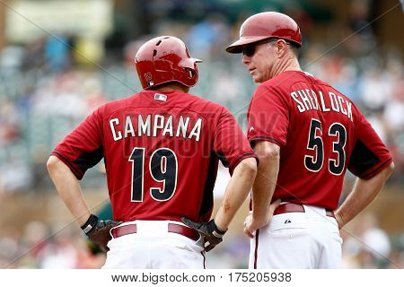 Arizona Diamondbacks outfielder Tony Campana speaks with third base coach Glenn Sherlock against the Oakland Athletics at Salt River Fields at Talking Stick on March 6, 2014 in Scottsdale, Arizona.