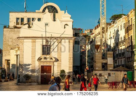 Lisbon, Portugal - Septmember 19, 2016: Street scene in old neighbourhood Mouraria Martim Moniz - Several unidentified pedestrians on the street walking, minding their business