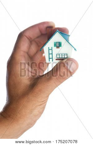 small house in man hand