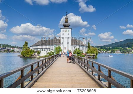 Schloss Orth With Famous Wooden Bridge At Lake Traunsee In Gmunden, Austria