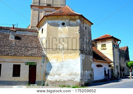 Fortified medieval church in the village Sanpetru, Transylvania. The landmark of the village is the 13th-century fortified church. The Order of Cistercians received it in 1240. The fortified church was severely destroyed during a Turkish invasion in 1432