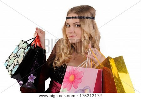 Young pretty woman holding shopping bags at white background.