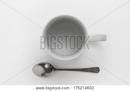 Top view of vintage ceramic cup for coffe or tea and spoon white background