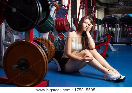 Beautiful Attractive Feminine Sensual Girl Take Breath During Fitness Workout At The Gym.