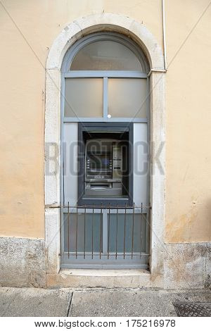Automated Teller Machine in Old Arch Window