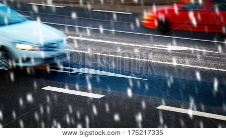 Cars driving along the crossroads on snowfall