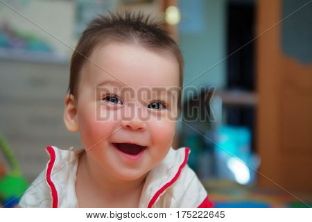 closeup portrait of child cute toddler girl with amazed smiling face