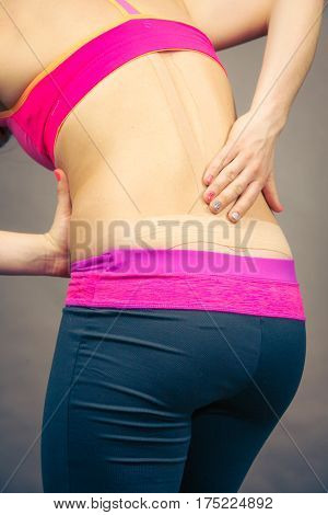 Woman With Medical Kinesio Taping On Back