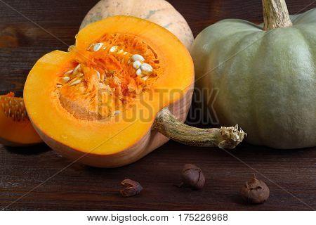 Fresh pumpkin on wooden background close up