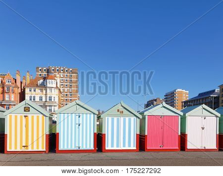 Lots of very colorful bathing huts in Brighton and Hove. No people and blue sky