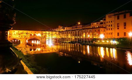 Bridge Ponte Vecchio at night in Florence, Italy