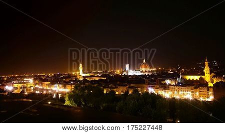 Florence city at night. Panoramic view to the river Arno, with Ponte Vecchio, Palazzo Vecchio and Cathedral of Santa Maria del Fiore (Duomo), Florence, Italy